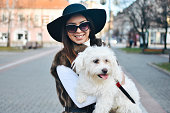 istock Attractive Girl and White Puppy 1203629325