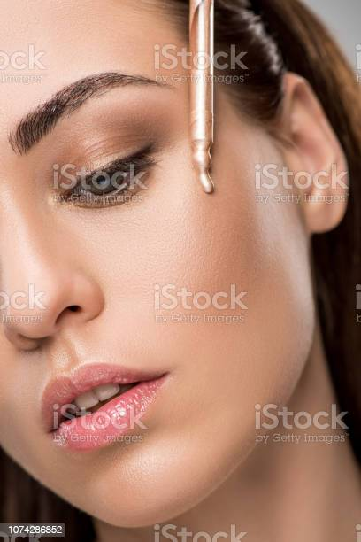 Attractive girl applying highlighter or bronzer with pipette picture id1074286852?b=1&k=6&m=1074286852&s=612x612&h=72n52ygffz8fayggvewg34omedm4oj2jpq9d j6xmh0=
