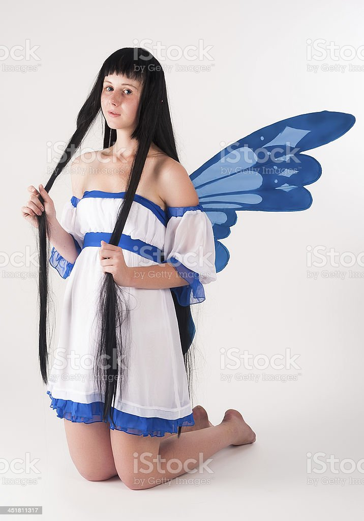 Attractive girl as fairy with wings stock photo