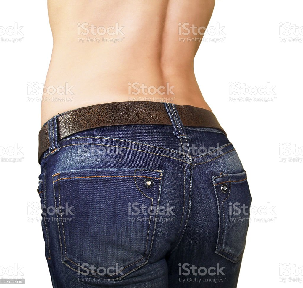 Attractive girl buttocks in jeans with tanned back stock photo