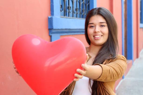 Attractive girl celebrating Saint Valentines stock photo