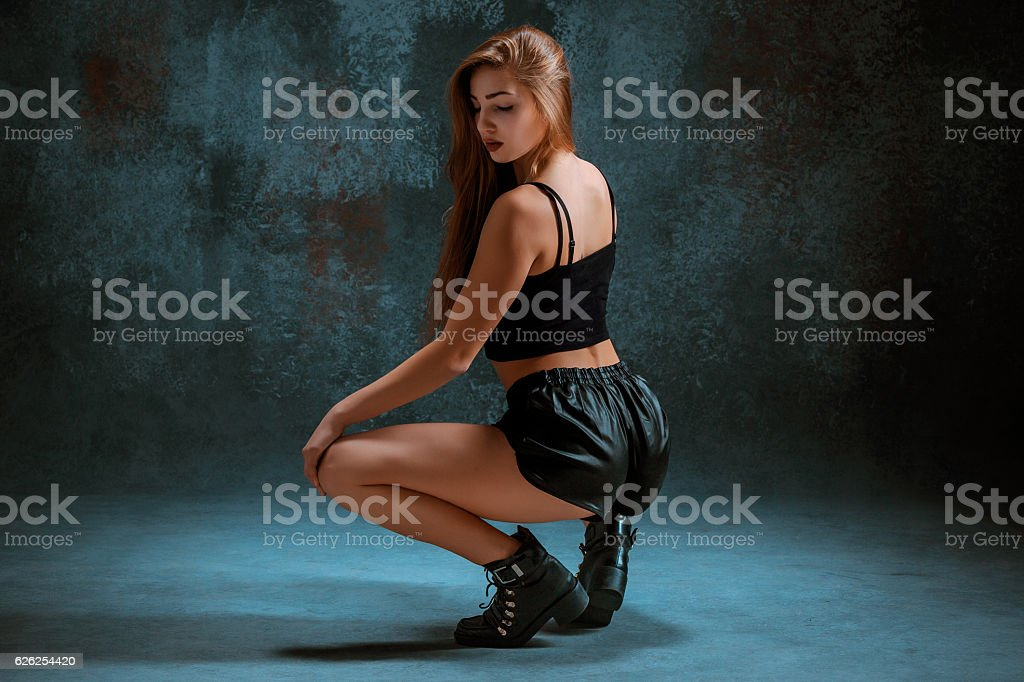 Attractive girl dancing twerk in the studio stock photo