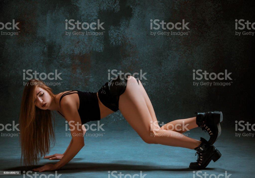 Attractive girl dancing twerk in the studio stock photo
