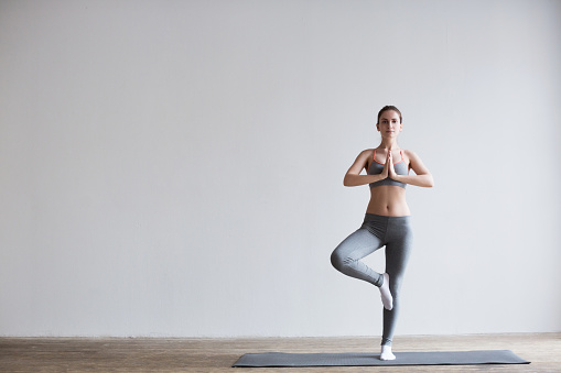 Young attractive girl do yoga.