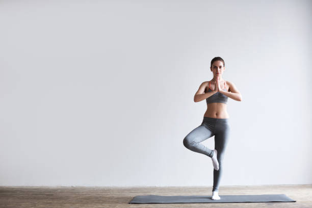 Attractive girl do yoga. Young attractive girl do yoga. yoga studio stock pictures, royalty-free photos & images