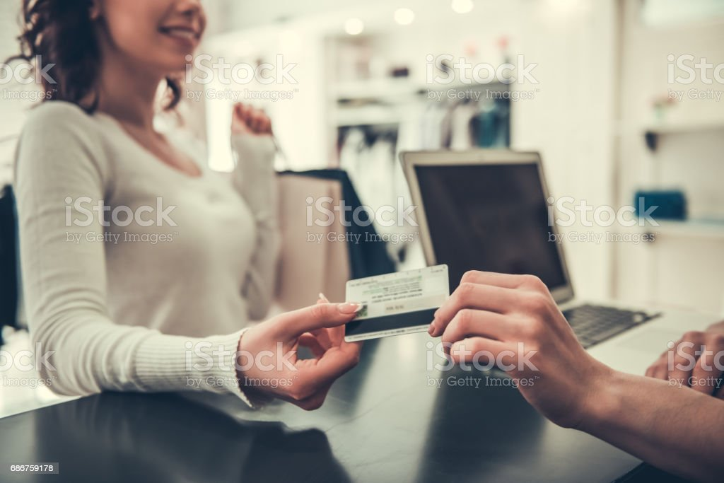 Attractive girl doing shopping stock photo