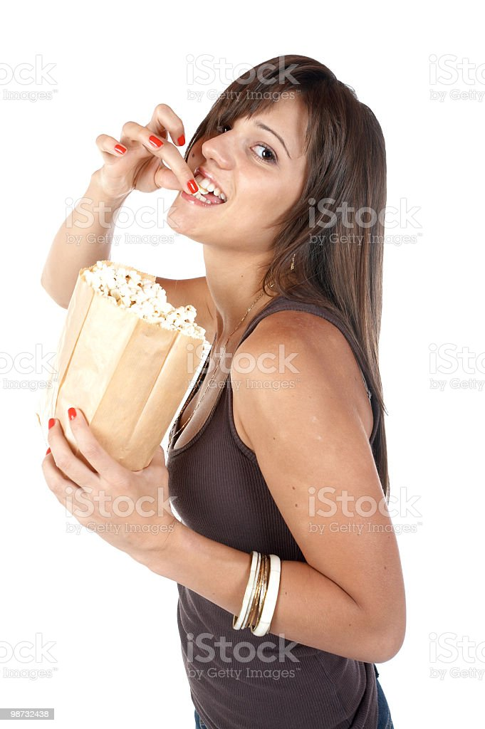 attractive girl eating popcorn royalty-free stock photo