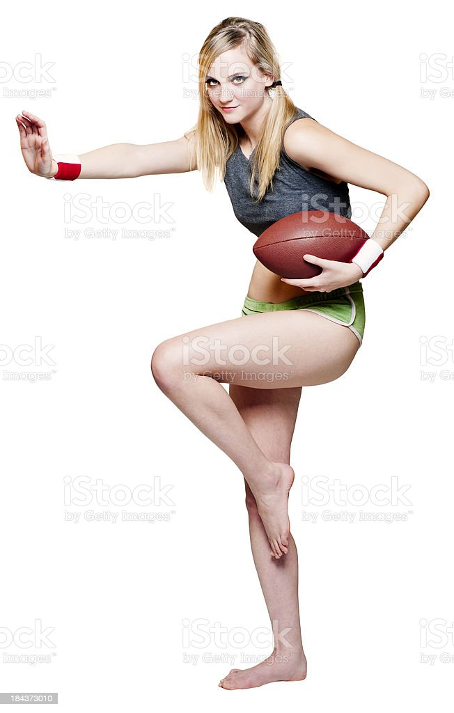 Attractive Girl in Football Pose stock photo