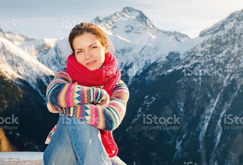 Attractive girl in winter Alps stock photo
