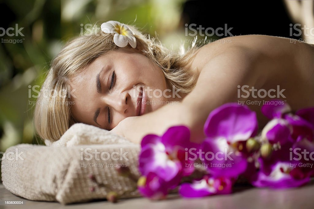 Attractive girl lying down at the spa resort. royalty-free stock photo