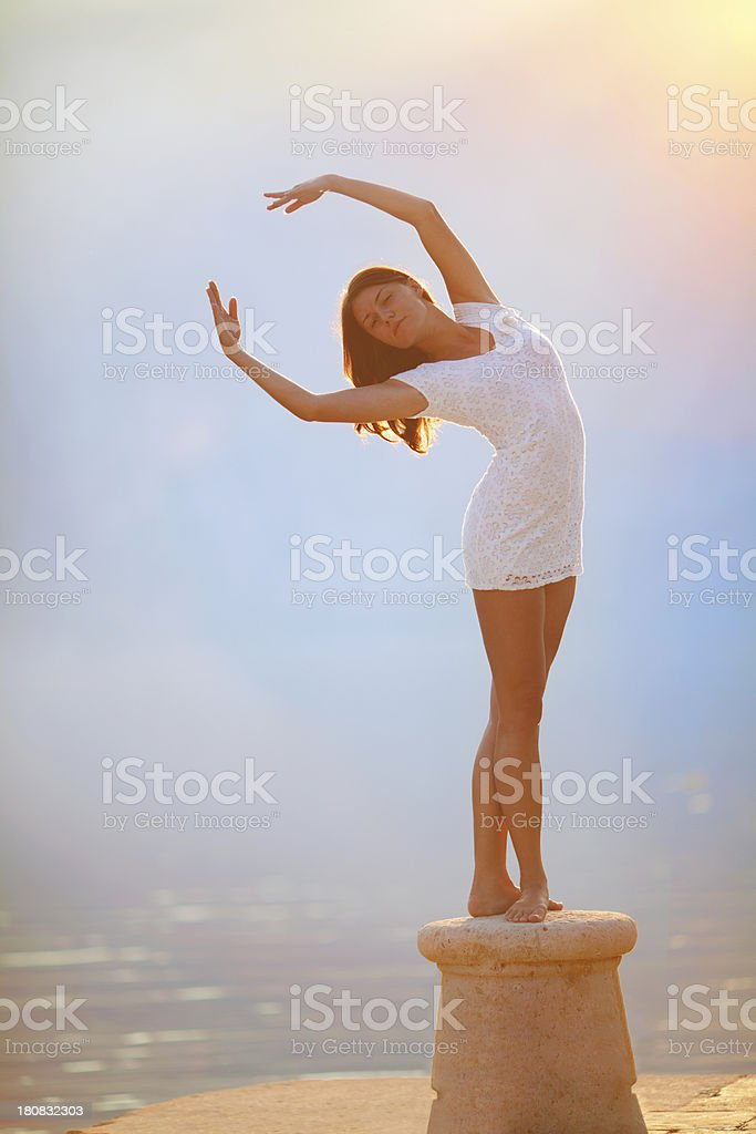 Attractive girl touching the sun royalty-free stock photo