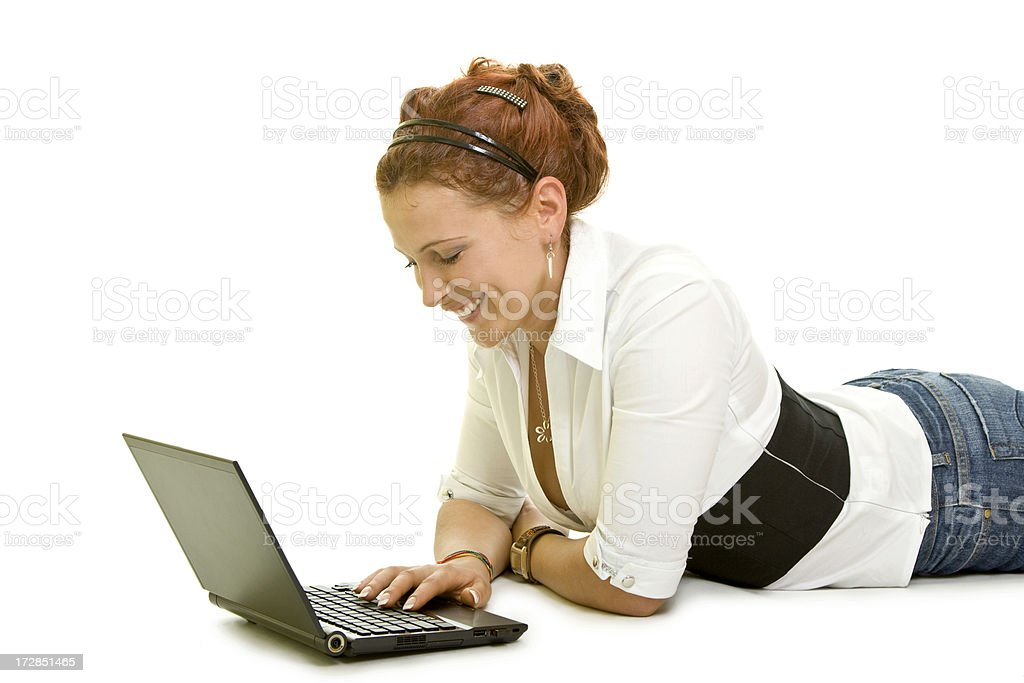 Attractive girl with a laptop isolated on white royalty-free stock photo