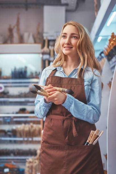 Attractive girl with brushes stock photo
