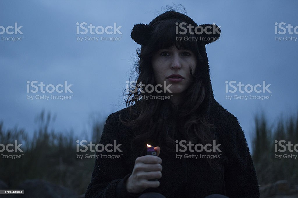Attractive Girl with Lighter in Night Time royalty-free stock photo