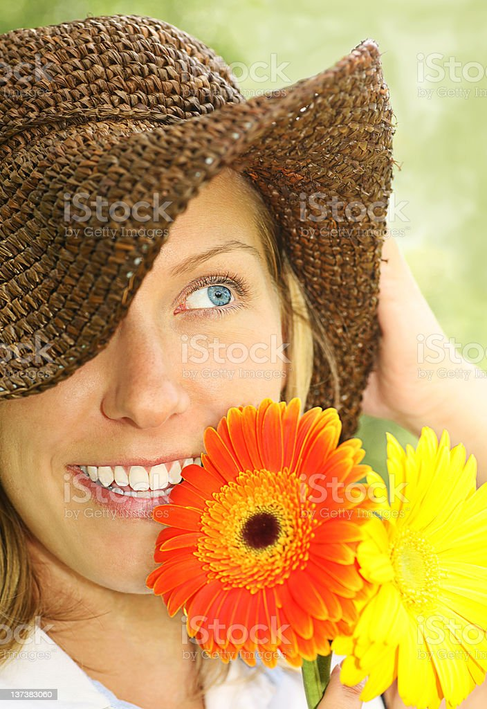 attractive girl with straw hat and daisies royalty-free stock photo