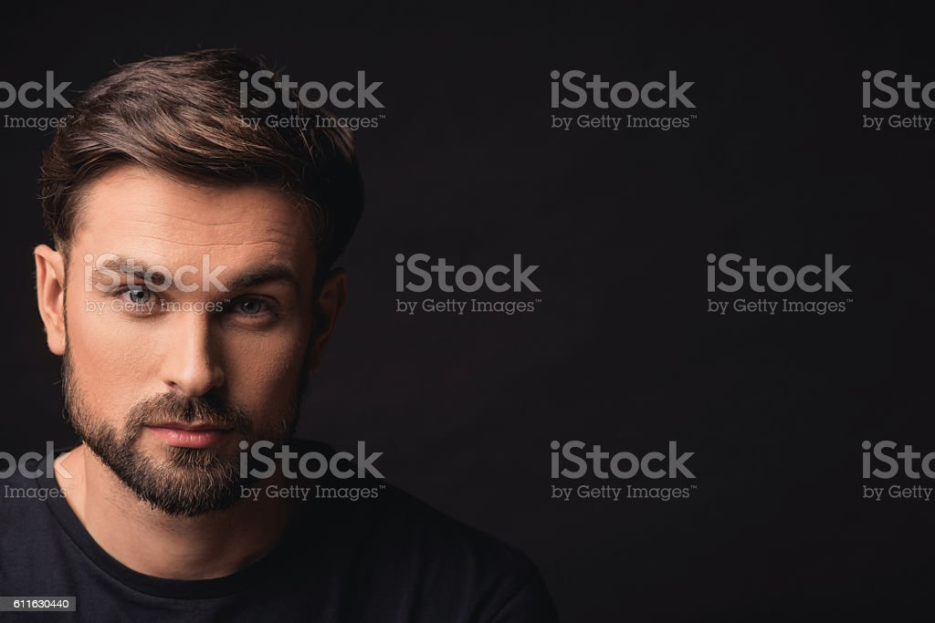 Attractive guy expressing his confidence stock photo