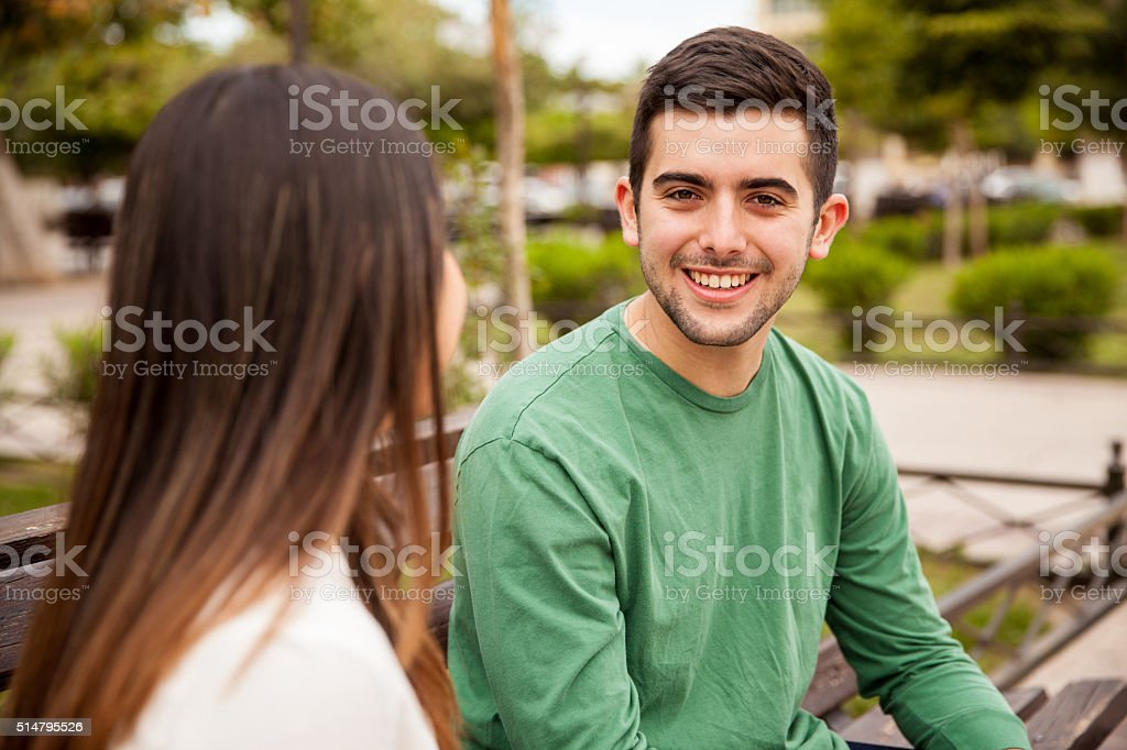 Attractive guy on a date at the park stock photo