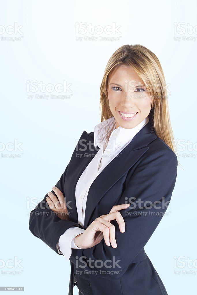 Attractive happy businesswoman with her arms crossed royalty-free stock photo
