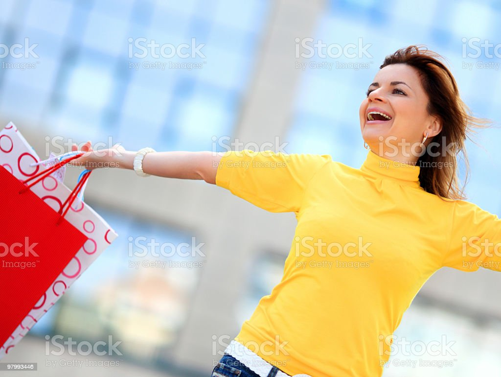 Attractive happy girl out shopping. royalty free stockfoto
