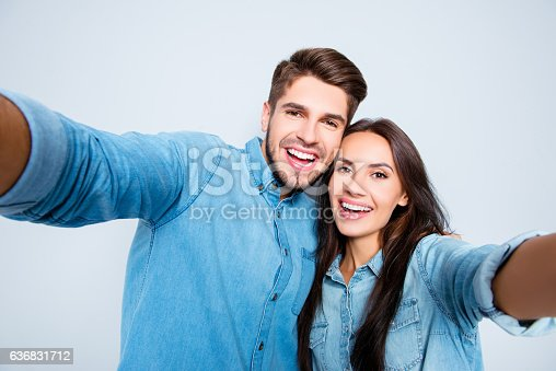 636831570 istock photo attractive happy man and woman in love making selfie 636831712