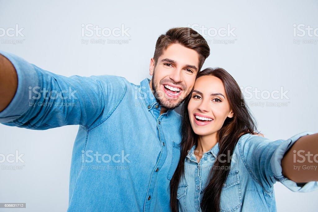 attractive happy man and woman in love making selfie - foto de acervo