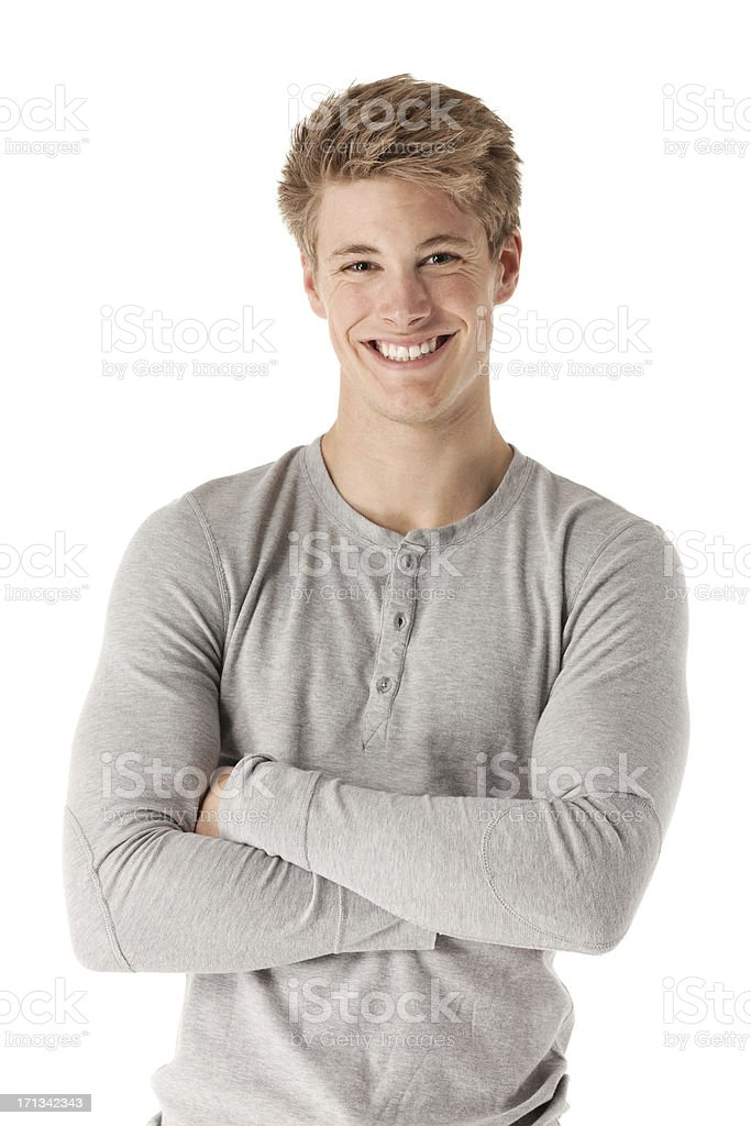 Attractive happy man standing with his arms crossed stock photo