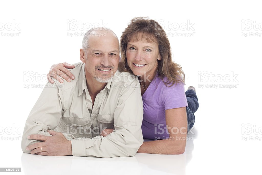Attractive Happy Mature Couple Lying on White Background royalty-free stock photo