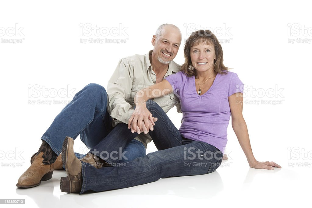 Attractive Happy Mature Couple Sitting on White Background royalty-free stock photo