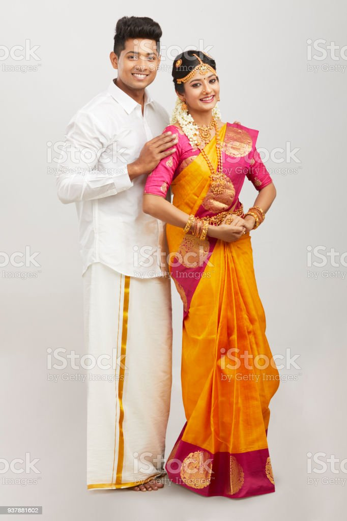 d674214b5 Attractive happy south Indian couple in traditional dress royalty-free  stock photo