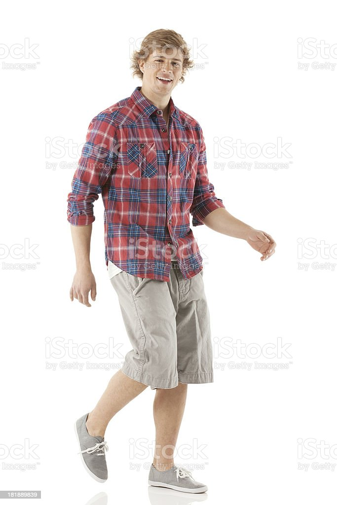 Attractive happy young man walking stock photo