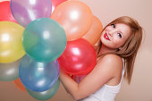 istock Attractive Happy Young Woman with Birthday Balloons 183559390