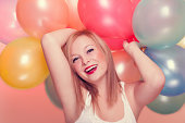 istock Attractive Happy Young Woman with Birthday Balloons 186135819