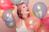 istock Attractive Happy Young Woman with Birthday Balloons 186138406