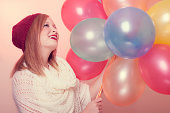 istock Attractive Happy Young Woman with Birthday Balloons 186205009