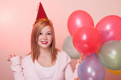 istock Attractive Happy Young Woman with Birthday Balloons 186570678