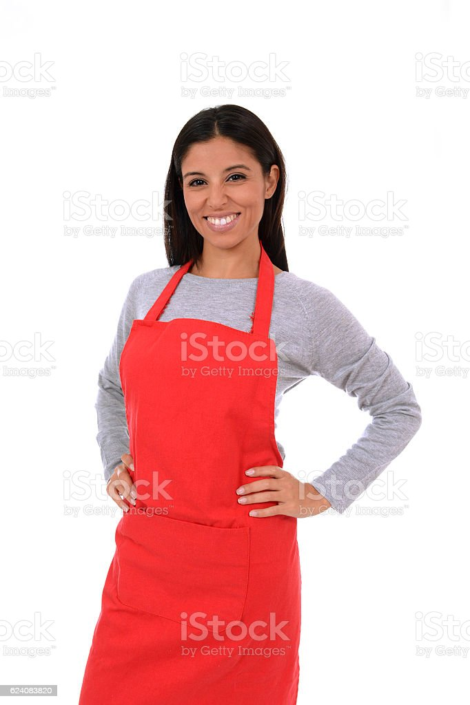 attractive hispanic home cook woman in red apron smiling happy stock photo