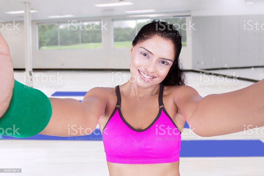 Attractive Indian woman taking selfie at gym zbiór zdjęć royalty-free