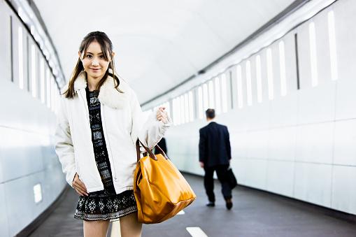 Attractive Japanese Woman Subway Corridor Stock Photo - Download Image Now
