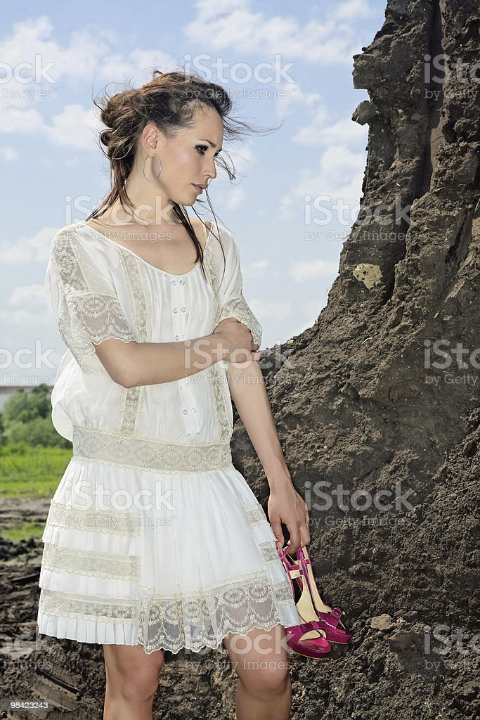 Attractive lady in white on soil quarry royalty-free stock photo