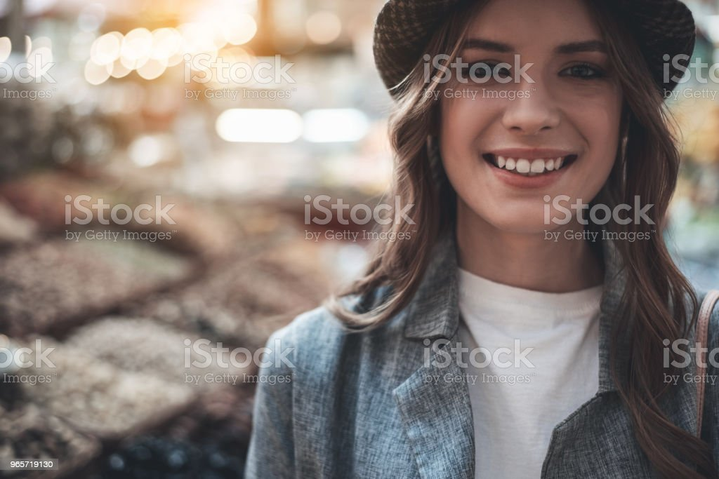 Attractive lady is grinning outdoors - Royalty-free Adult Stock Photo