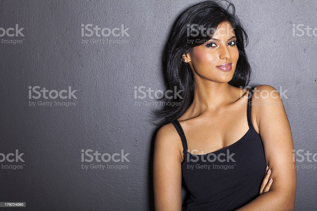 attractive latin fashion woman on black wall stock photo