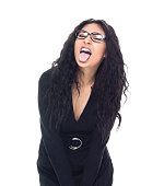 istock Attractive latino busineswoman is making a silly face 1161514331