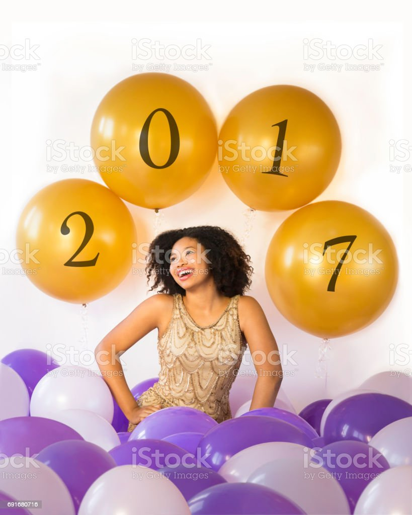 Attractive laughing young woman celebrates in 2017 stock photo