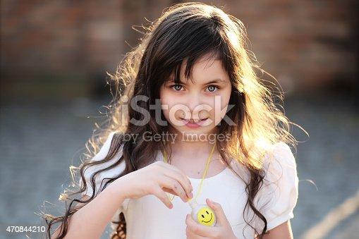istock Attractive little girl looking forward, outdoor 470844210