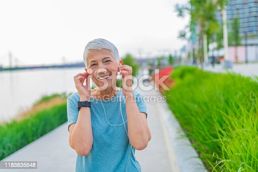 497687118istockphoto Attractive looking mature woman keeping fit and healthy. 1183835548