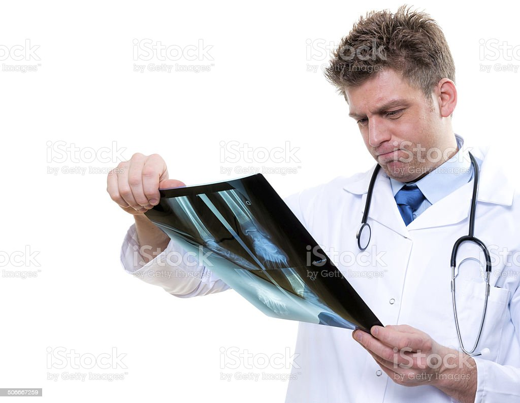 attractive male doctor examining foot x-ray royalty-free stock photo