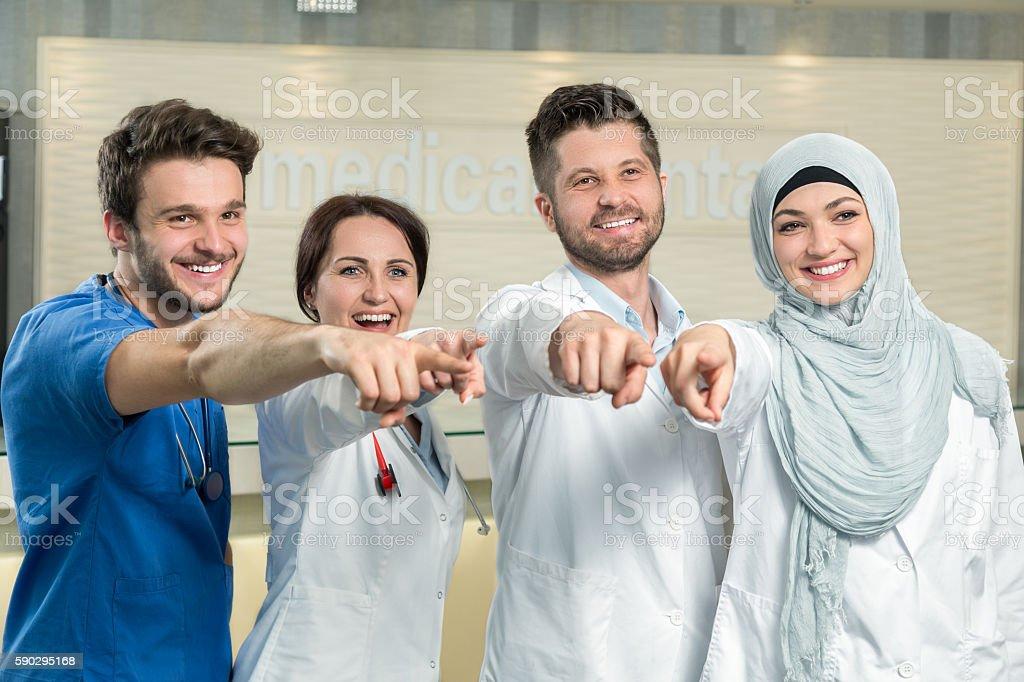 attractive male doctor in front of medical group royaltyfri bildbanksbilder