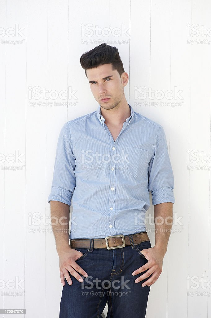 Attractive male fashion model in blue jeans and shirt royalty-free stock photo
