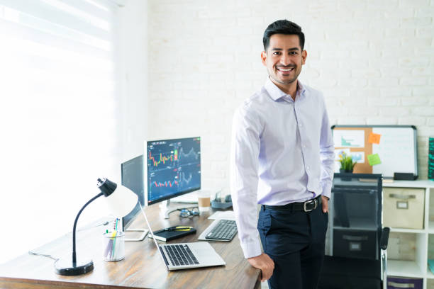 Attractive Male Finance Professional Working At Home stock photo