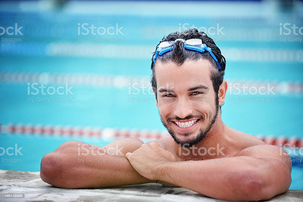 Attractive male in a swimming pool royalty-free stock photo